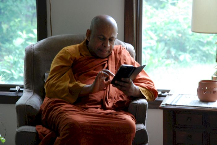 Visiting monk staying connected with his temple