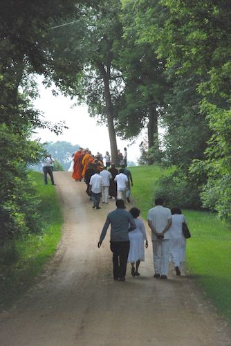 Walking to the highway for the unveiling of the Metta Meditation Center sign.