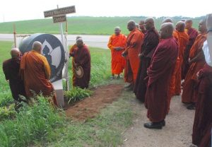 Monks at revealing new sign at the Metta Meditation Center in Janesville, MN
