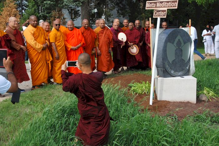 Taking pictures of the unveiling the Metta Meditation Center sign