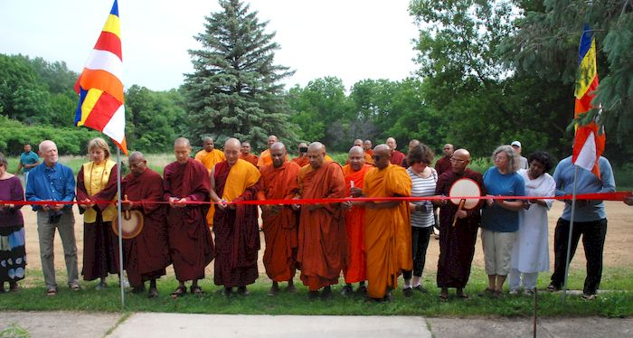 Getting ready to cut the ribbon at the Metta Meditation Center