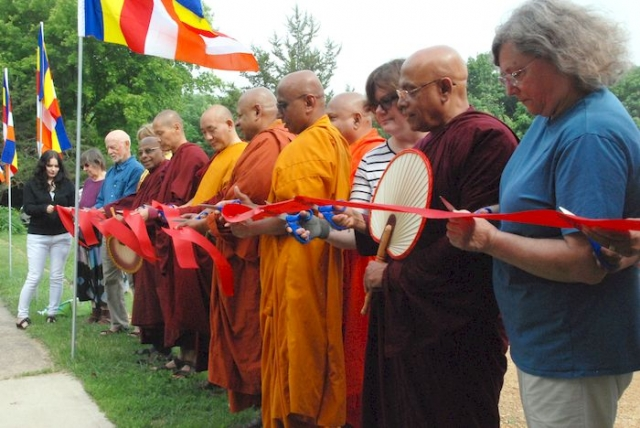 Cutting the ribbon at the Metta Meditation Center