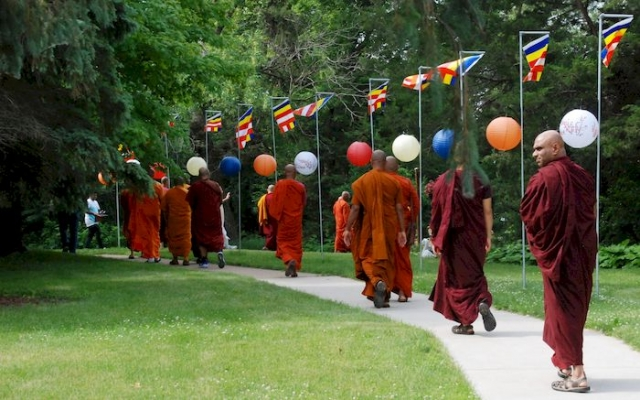 Monks walking to the lake for the dedication ceremony for the Metta Meditation Center