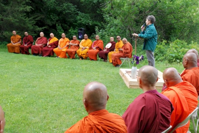 Sister speaking to the monks about the history of the center
