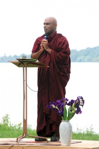 Bhante Sathi telling his story about coming to Minnesota