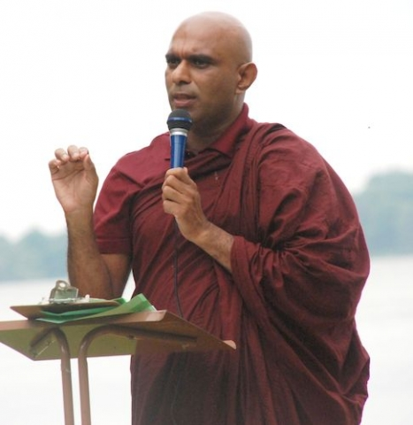 Bhante Sathi describing the history of Triple Gem