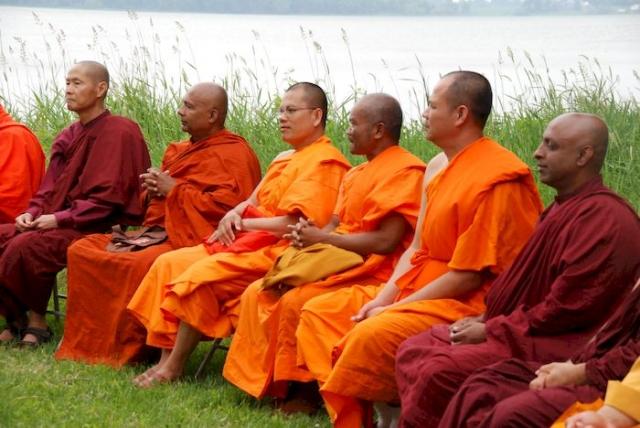 Monks listening to the presentation at the Metta Meditation Center