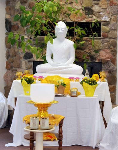 The altar at the Metta Meditation Center with the Buddha and crystal singing bowl.