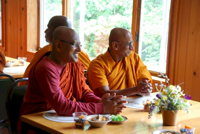 Monks getting ready for lunch at Bhanti      at the open house for the Metta Meditation Center