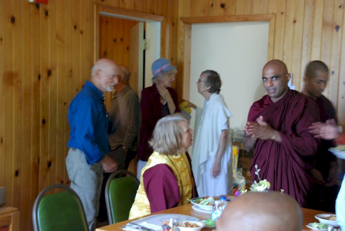 Bhante Sathi talking with visitors before lunch