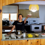 Amy serving up great food from the kitchen at the Metta Meditation Center