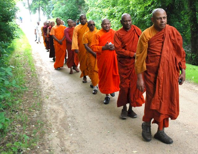 Monks walking back to the Metta Meditation Center