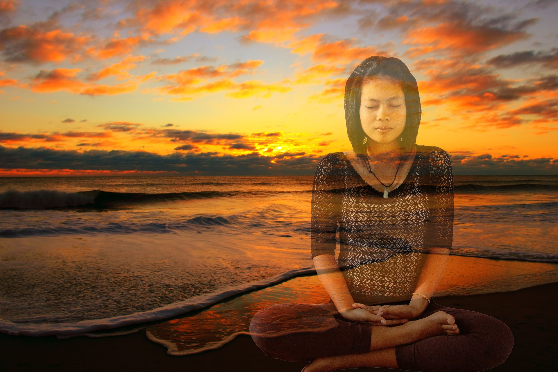 Woman meditating in the sunset
