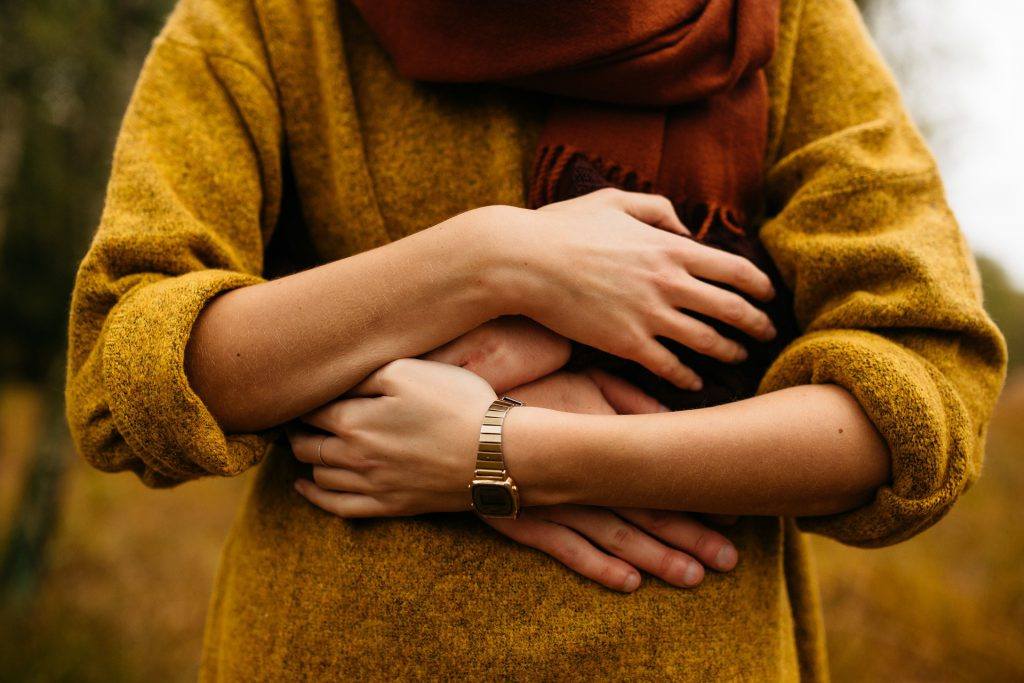 Person giving themself a hug